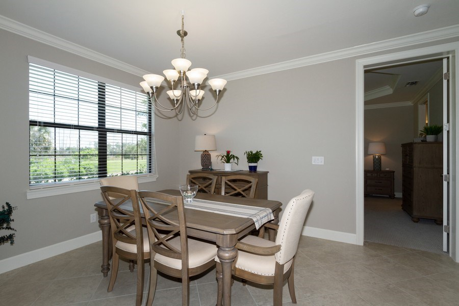 Real Estate Photography - 8777 Bellano Ct #101, Naples, FL, 34119 - Dining Room