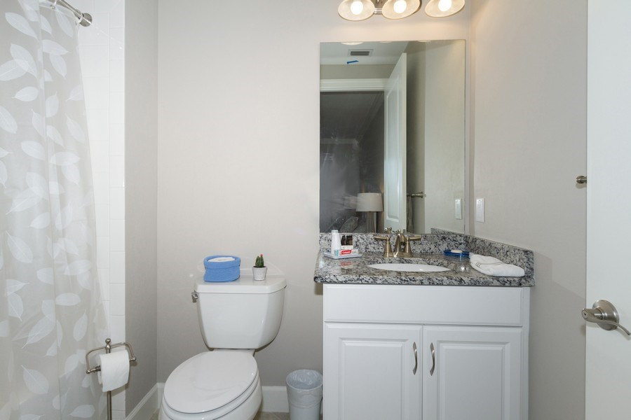 Real Estate Photography - 8777 Bellano Ct #101, Naples, FL, 34119 - Bathroom