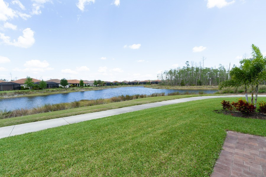 Real Estate Photography - 8777 Bellano Ct #101, Naples, FL, 34119 - Lake View