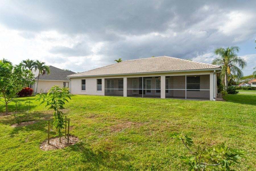 Real Estate Photography - 257 Lambton Ln, Naples, FL, 34104 - Rear View