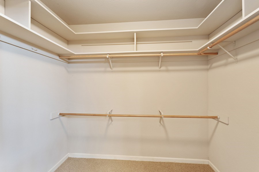 Real Estate Photography - 896 Ridgeview Dr, Woodland, CA, 95695 - Master Bedroom Closet