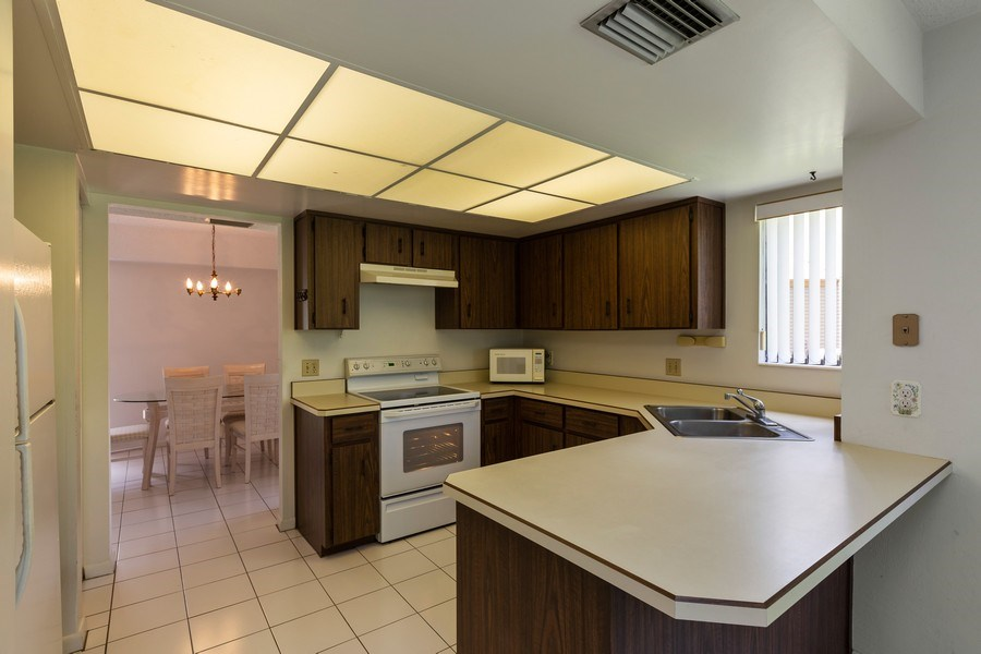 Real Estate Photography - 31 Oxford Lane, Palm Coast, FL, 32137 - Kitchen