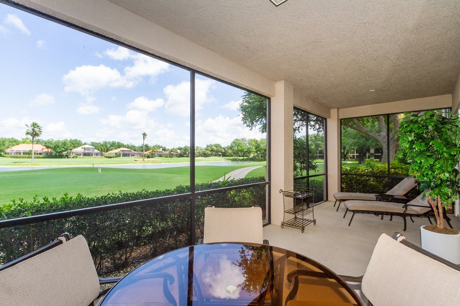 Real Estate Photography - 806 Regency Reserve Circle #902, Naples, FL, 34119 - 40' Screened Lanai Fully Opens to DR