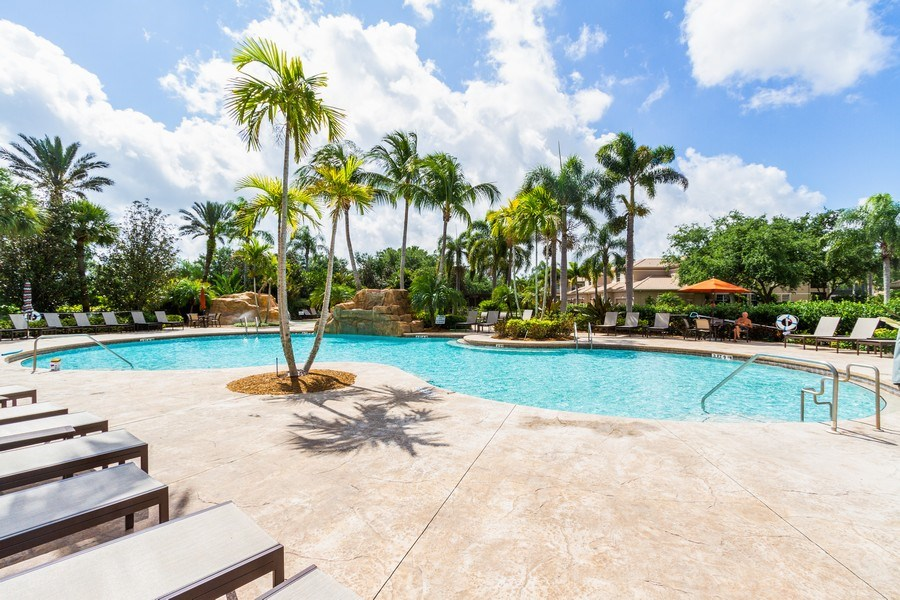 Real Estate Photography - 806 Regency Reserve Circle #902, Naples, FL, 34119 - Resort Style Pool with 3 Waterfalls and Whirlpool