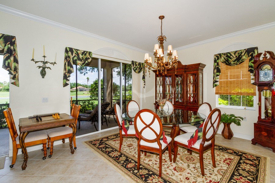 Real Estate Photography - 806 Regency Reserve Circle #902, Naples, FL, 34119 - Dining Room Opened to Living Room