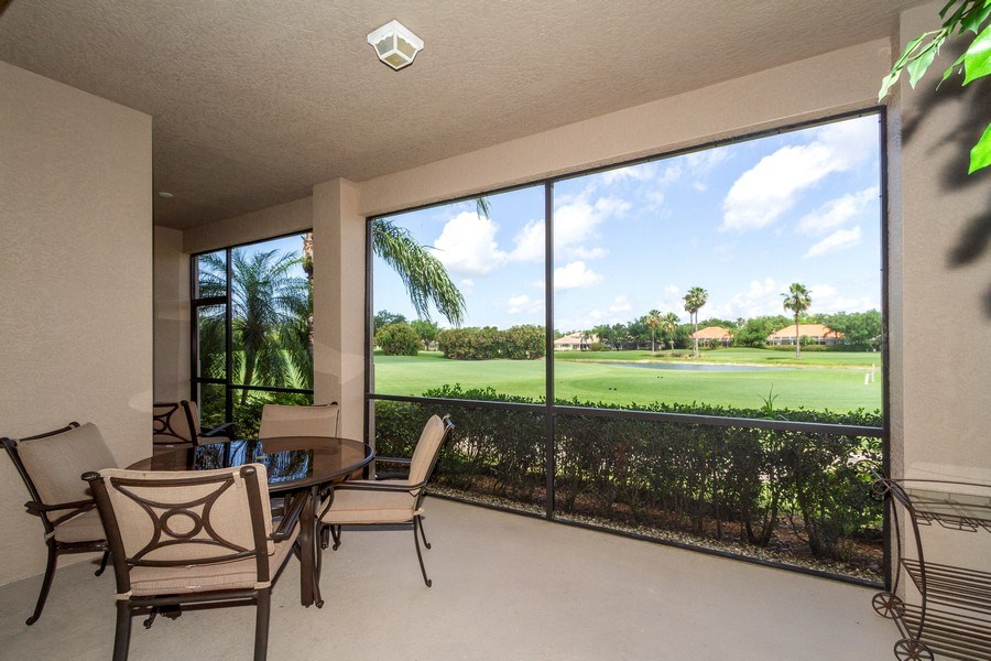 Real Estate Photography - 806 Regency Reserve Circle #902, Naples, FL, 34119 - 40' Screened Lanai Fully Opens to LR