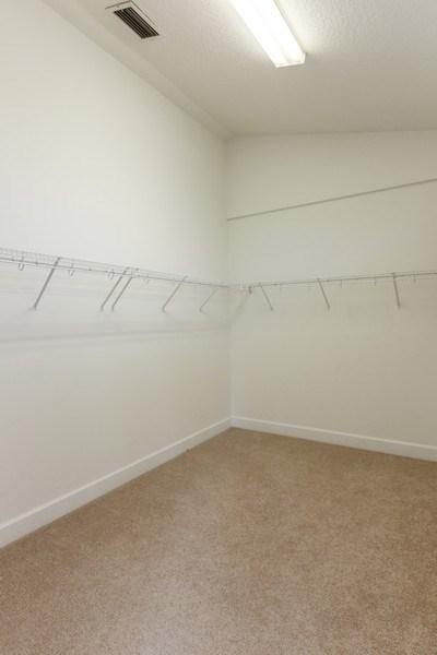 Real Estate Photography - 12 Remington Road, Ormond Beach, FL, 32174 - Master Bedroom Closet