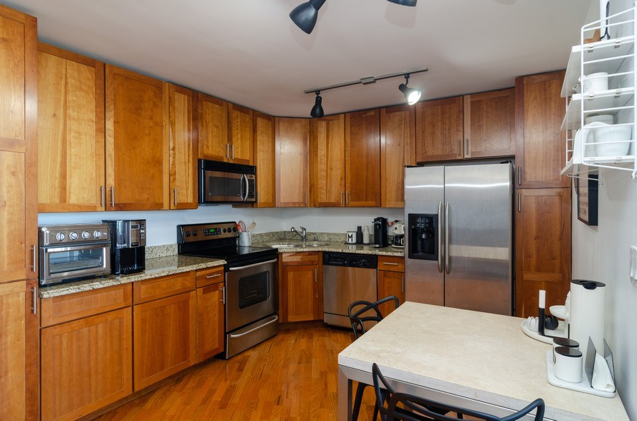 Real Estate Photography - 655 Irving Park, Unit 5104, Chicago, IL, 60613 - Kitchen