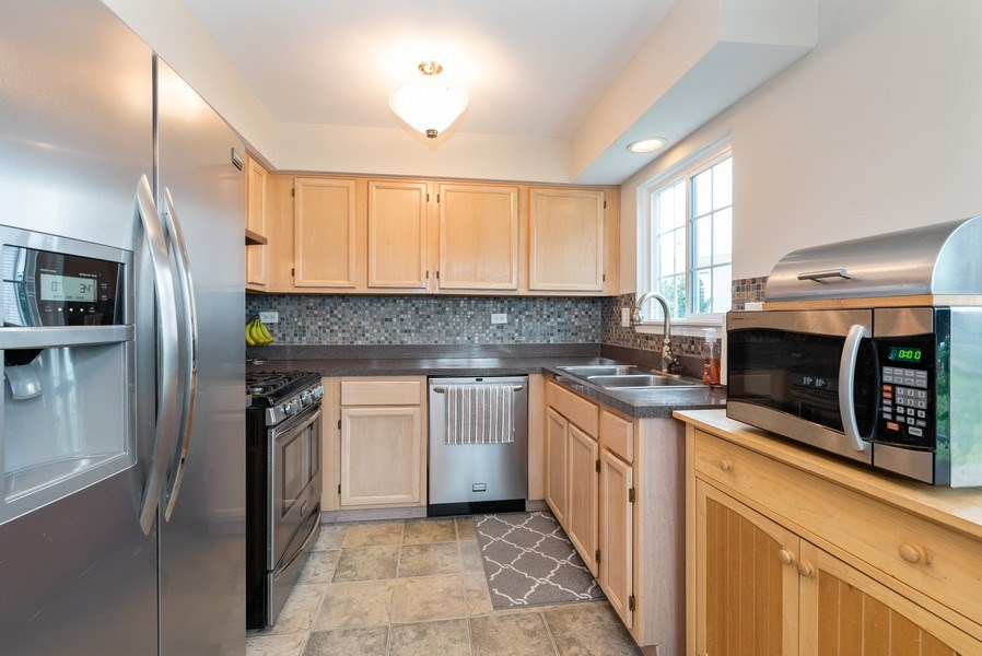 Real Estate Photography - 1120 Longford Road, Bartlett, IL, 60103 - Kitchen