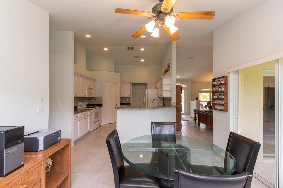 Real Estate Photography - 1476 Honeysuckle Avenue, Marco Island, FL, 34145 - Kitchen / Dining Room