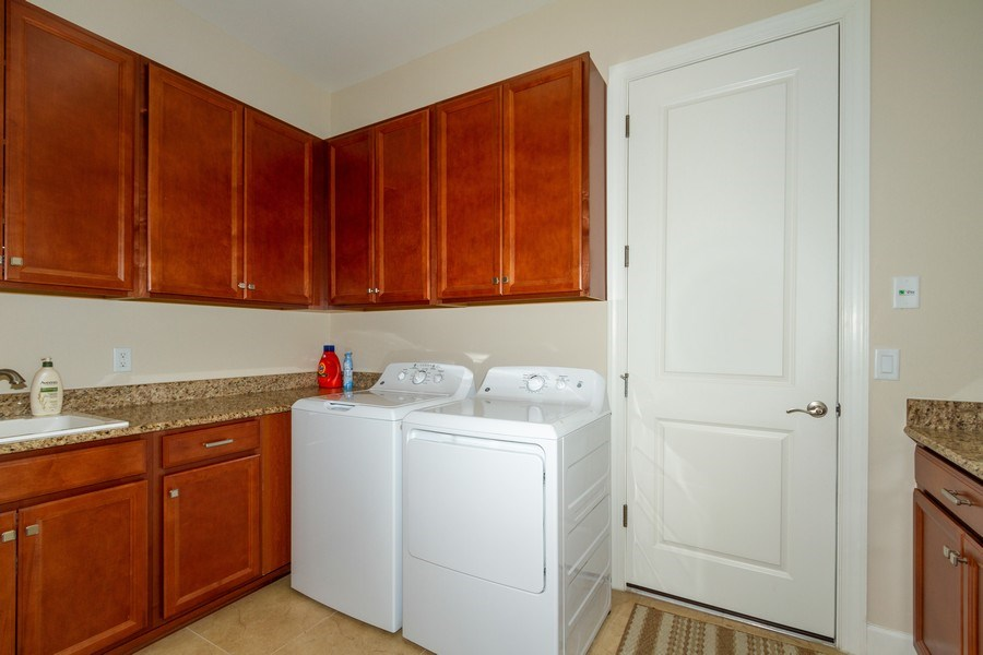 Real Estate Photography - 8851 Vacarro Ct, Naples, FL, 34119 - Laundry Room