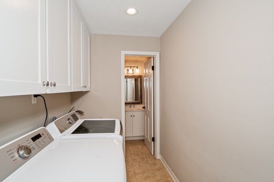 Real Estate Photography - 421 Park North Ct, Winter Park, FL, 32789 - Laundry Room & Powder Bath