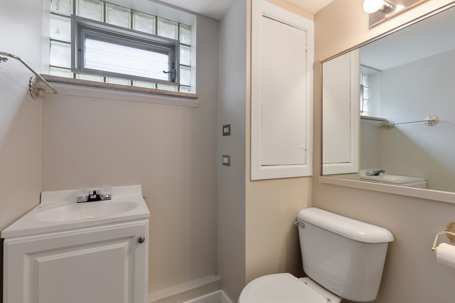 Real Estate Photography - 1821 N. 75th Ct, Elmwood Park, IL, 60707 - 3rd Bathroom