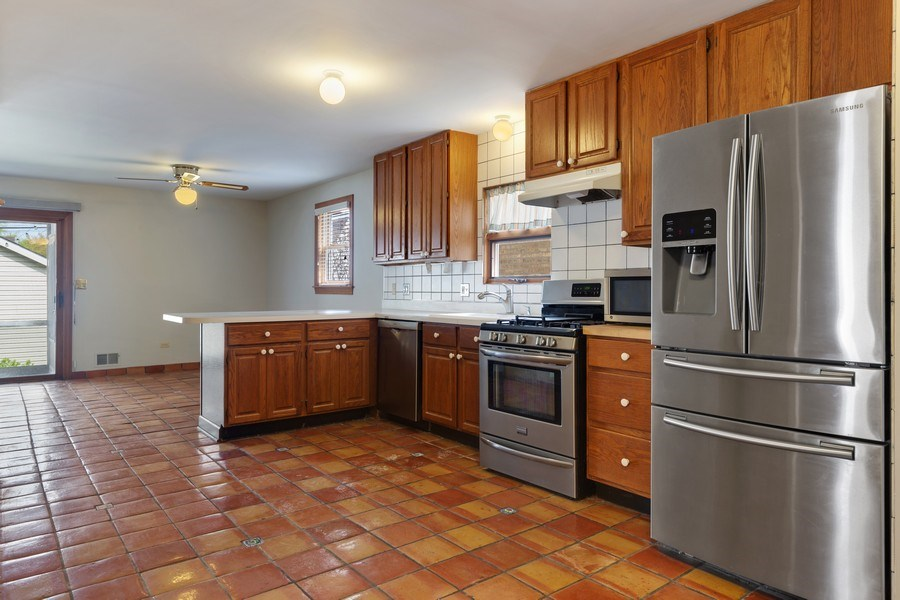 Real Estate Photography - 1821 N. 75th Ct, Elmwood Park, IL, 60707 - Kitchen