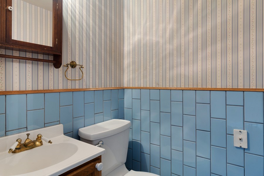 Real Estate Photography - 1821 N. 75th Ct, Elmwood Park, IL, 60707 - 2nd Bathroom