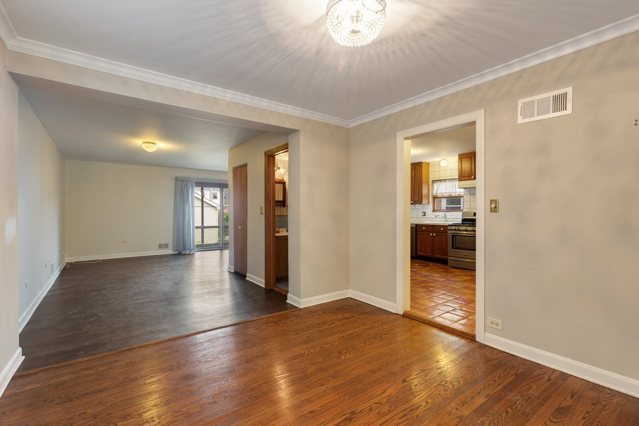 Real Estate Photography - 1821 N. 75th Ct, Elmwood Park, IL, 60707 - Family Room / Dining Room