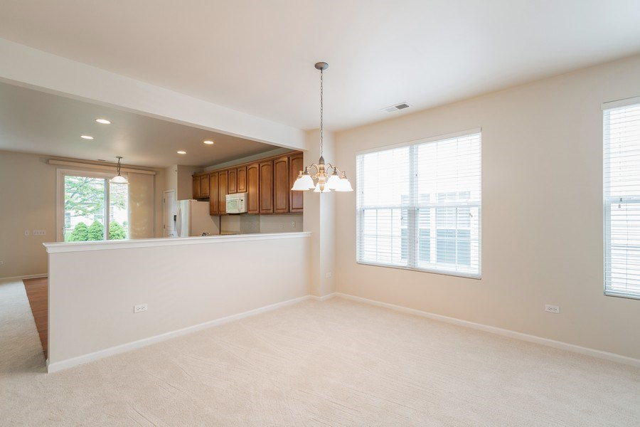 Real Estate Photography - 13973 Redmond Dr, Huntley, IL, 60142 - Dining Room