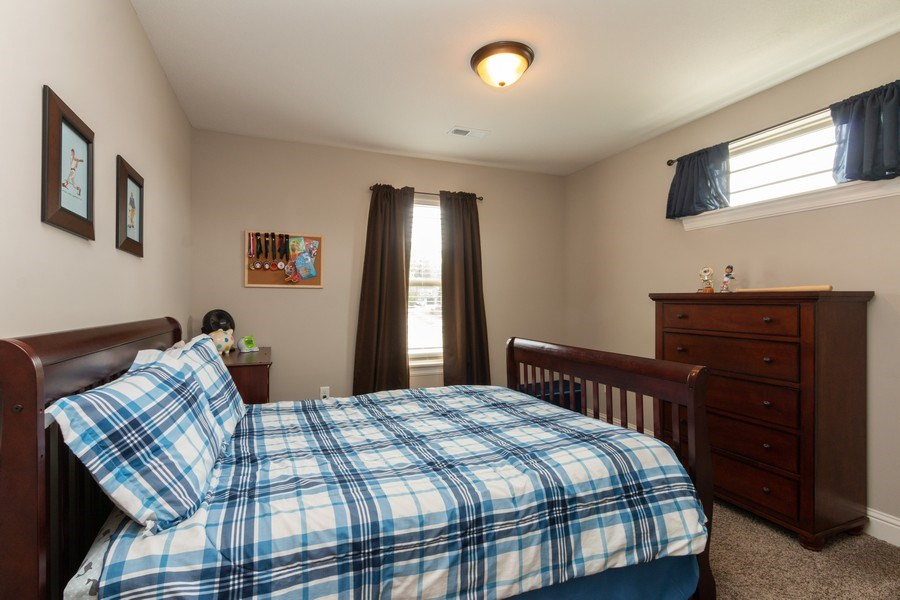 Real Estate Photography - 1915 S Cochise Ave, Independence, MO, 64057 - Guest Bedroom