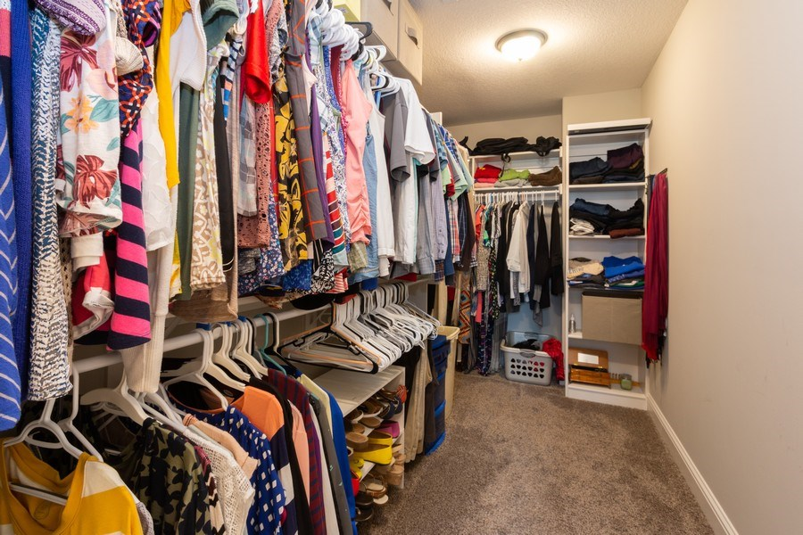 Real Estate Photography - 1915 S Cochise Ave, Independence, MO, 64057 - Master Bedroom Closet