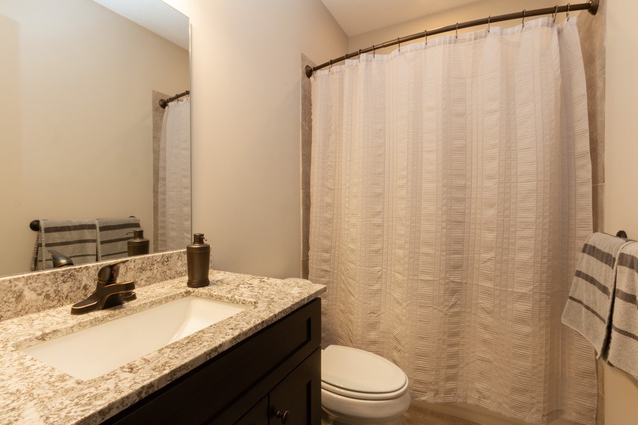 Real Estate Photography - 1915 S Cochise Ave, Independence, MO, 64057 - 2nd Bathroom
