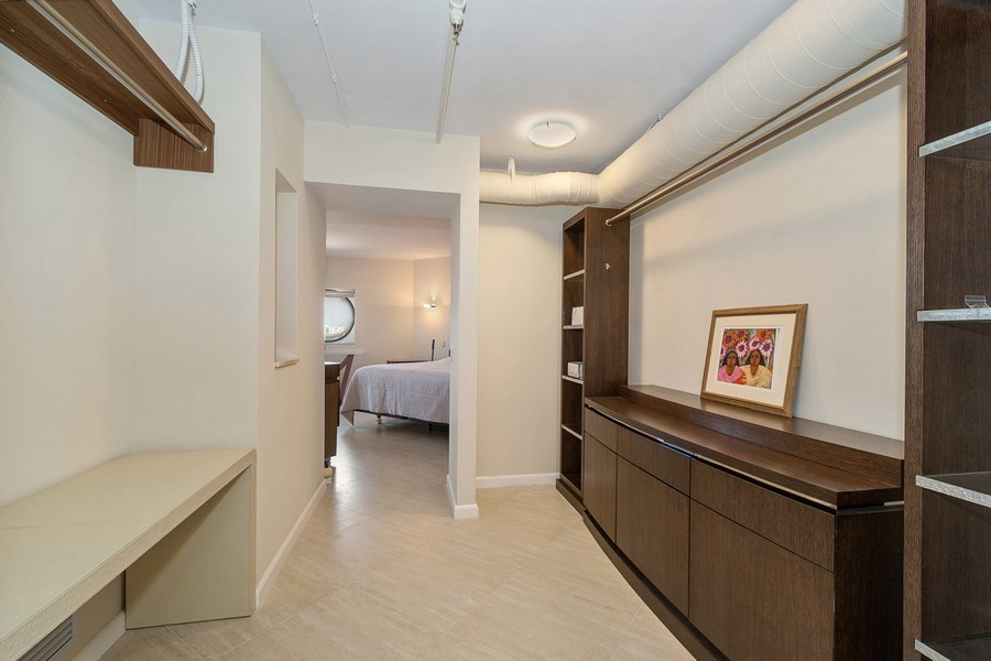 Real Estate Photography - 3610 Yacht Club Dr, 1114, Aventura, FL, 33180 - Master Bedroom Closet