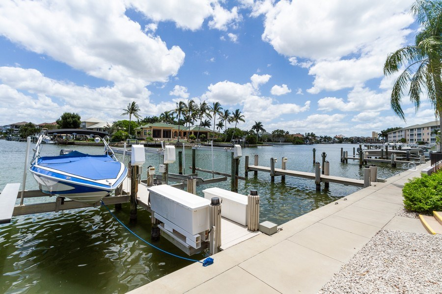 Real Estate Photography - 11030 Gulf Shore Blvd unit 304, Naples, FL, 34108 - Dock