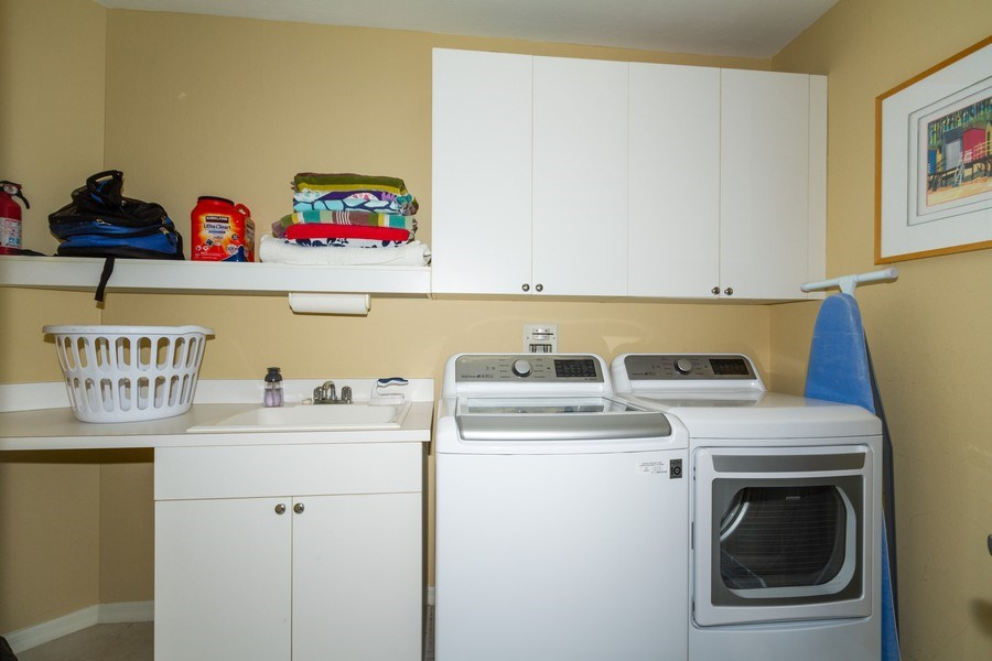 Real Estate Photography - 410 FLAGSHIP DR #1105, Naples, FL, 34108 - Laundry Room