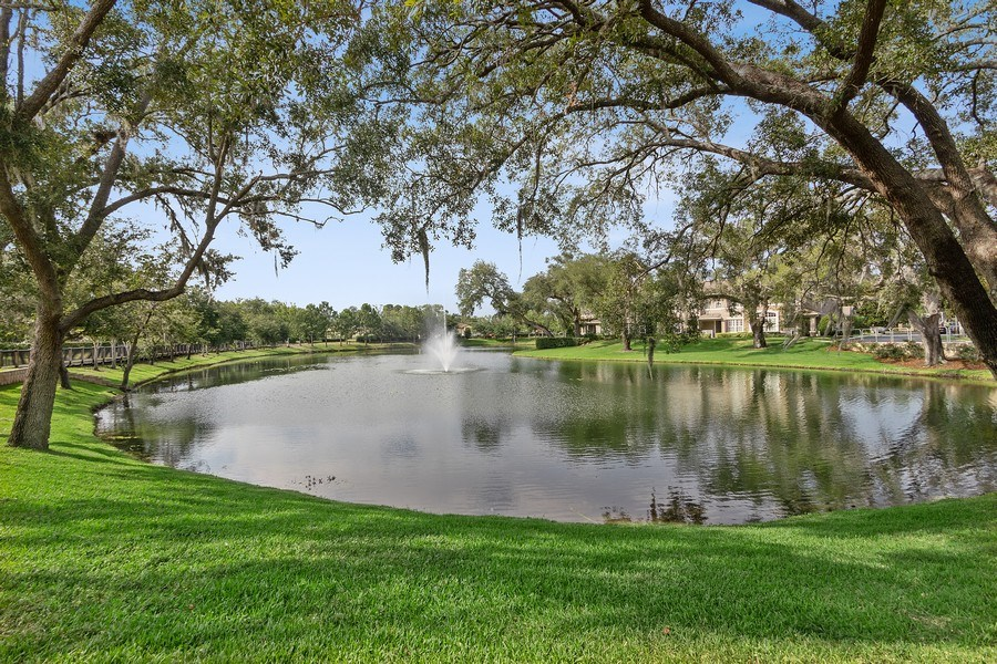 Real Estate Photography - 517 Shining Armor Ln, Longwood, FL, 32779 - Beautiful Pond in Complex with Seating and Walking
