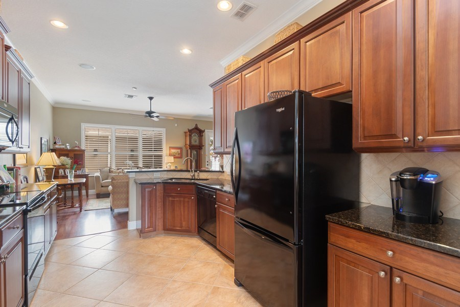 Real Estate Photography - 517 Shining Armor Ln, Longwood, FL, 32779 - Kitchen Upgraded cabinets with Granite