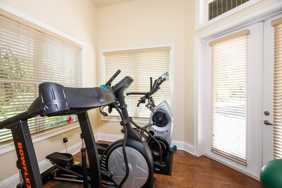 Real Estate Photography - 11441 Hammock Oaks, Lithia, FL, 33547 - Exercise Room