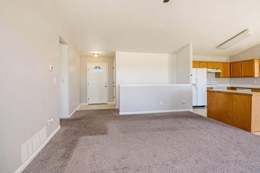 Real Estate Photography - 1051 Fairacres Ln, Milliken, CO, 80543 - Living Room