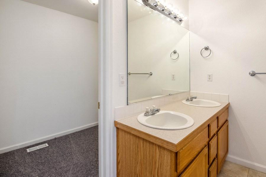 Real Estate Photography - 1051 Fairacres Ln, Milliken, CO, 80543 - Master Bathroom