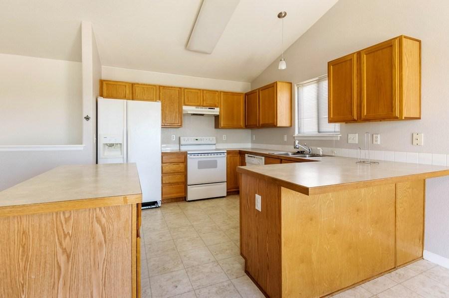 Real Estate Photography - 1051 Fairacres Ln, Milliken, CO, 80543 - Kitchen