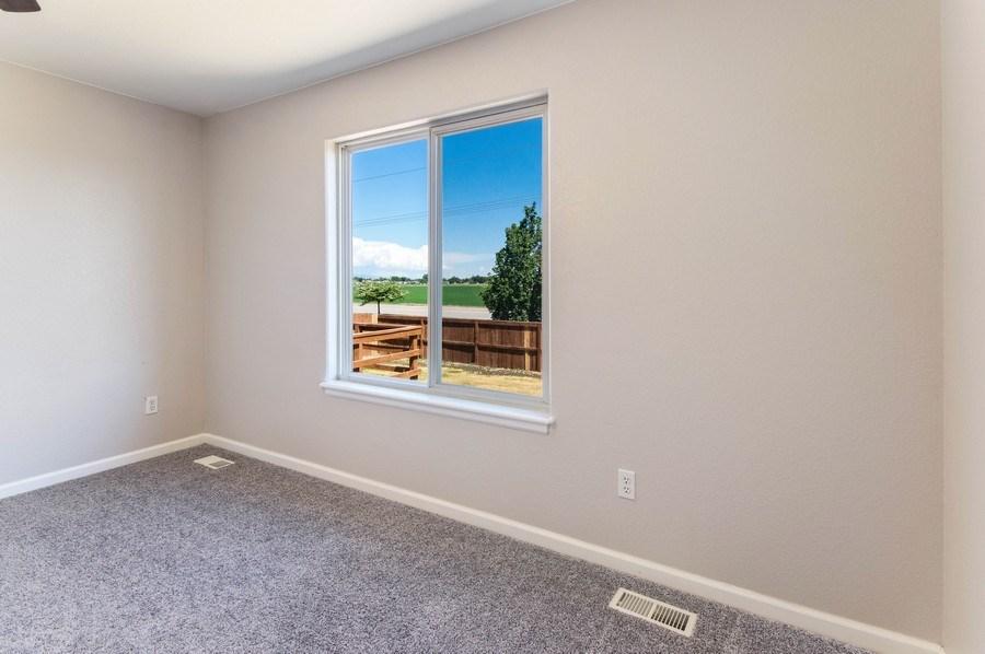 Real Estate Photography - 1051 Fairacres Ln, Milliken, CO, 80543 - Master Bedroom