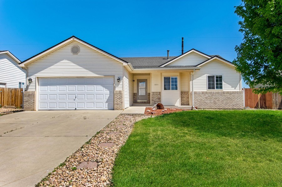 Real Estate Photography - 1051 Fairacres Ln, Milliken, CO, 80543 - Front View