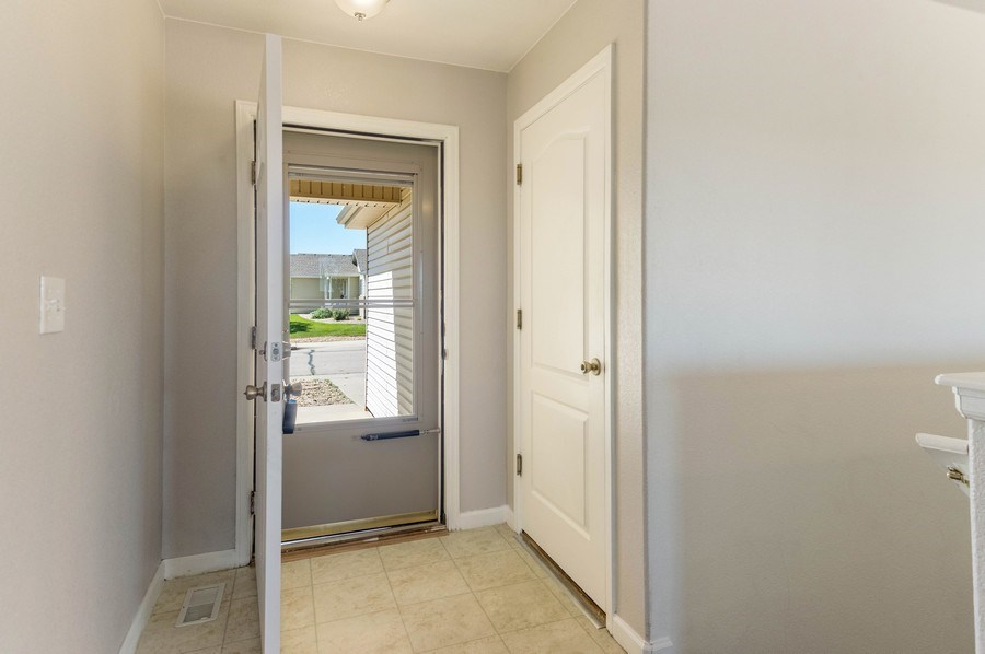 Real Estate Photography - 1051 Fairacres Ln, Milliken, CO, 80543 - Foyer