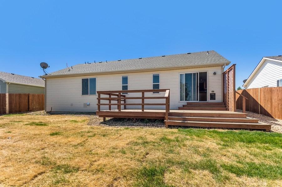 Real Estate Photography - 1051 Fairacres Ln, Milliken, CO, 80543 - Rear View