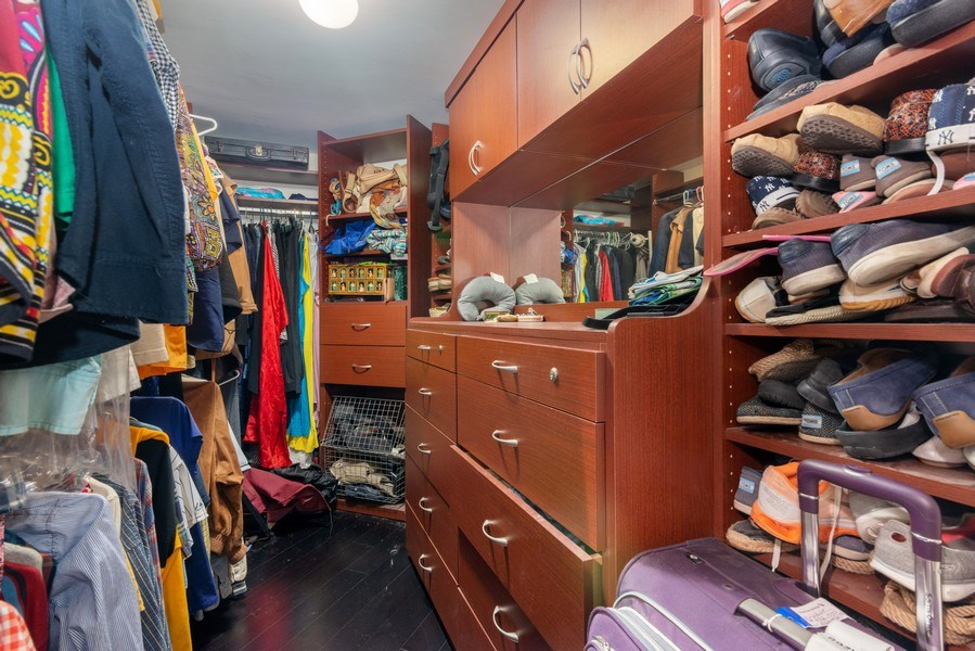 Real Estate Photography - 55 Merrick Way, Apt 503, Coral Gables, FL, 33134 - Master Bedroom Closet