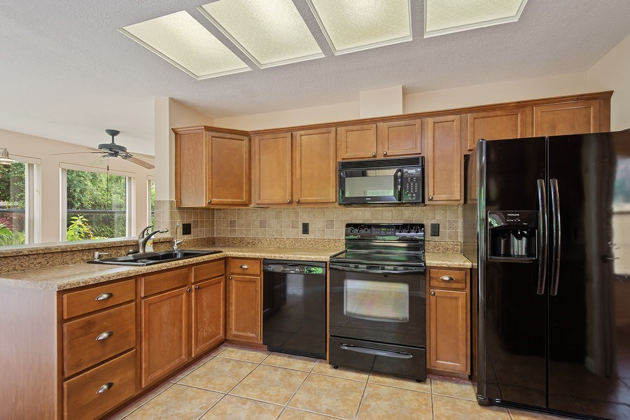 Real Estate Photography - 1908 Sandstone Place, Clearwater, FL, 33760 - Kitchen