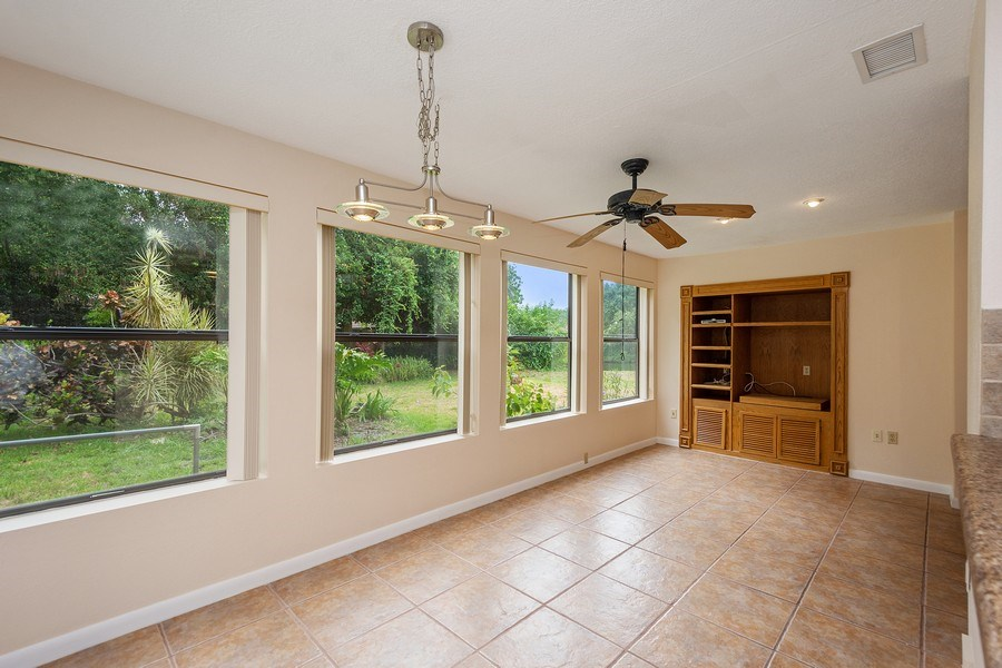 Real Estate Photography - 1908 Sandstone Place, Clearwater, FL, 33760 - Dining Room