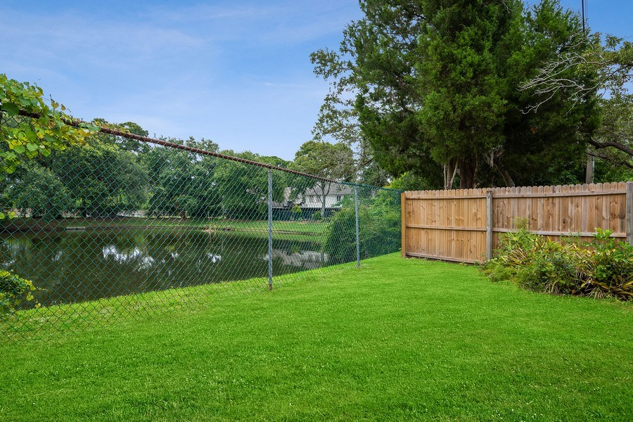 Real Estate Photography - 1908 Sandstone Place, Clearwater, FL, 33760 - Back Yard