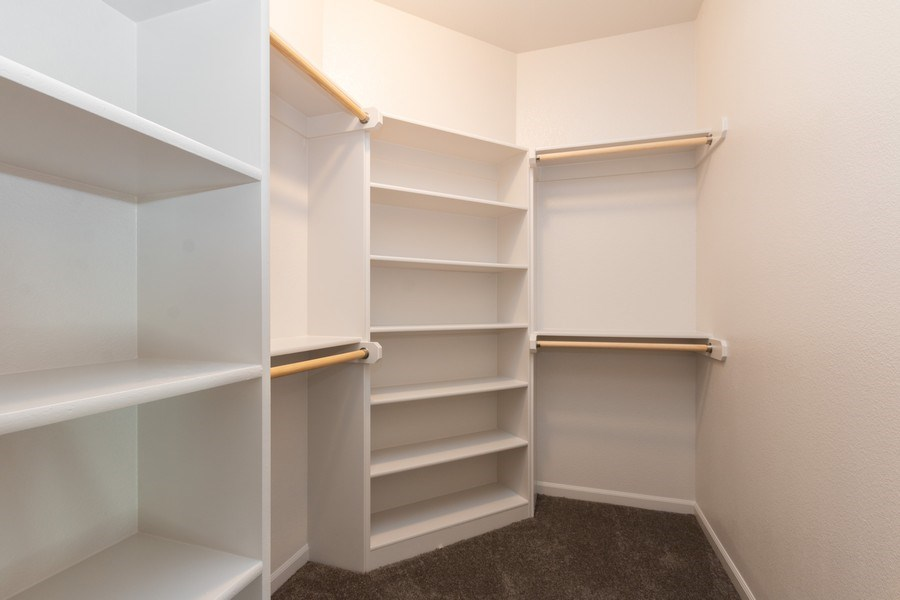 Real Estate Photography - 9390 Brownridge, Lenexa, KS, 66220 - Master Bedroom Closet