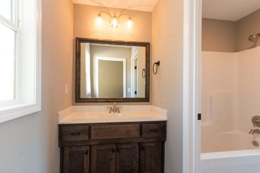 Real Estate Photography - 21601 W 93rd Ter, Lenexa, KS, 66220 - 3rd Bathroom