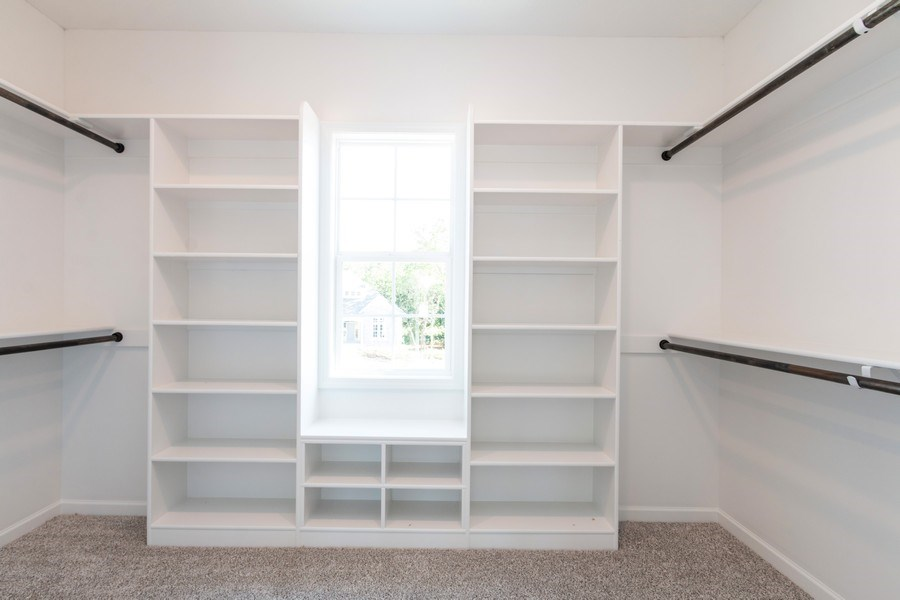 Real Estate Photography - 21601 W 93rd Ter, Lenexa, KS, 66220 - Master Bedroom Closet