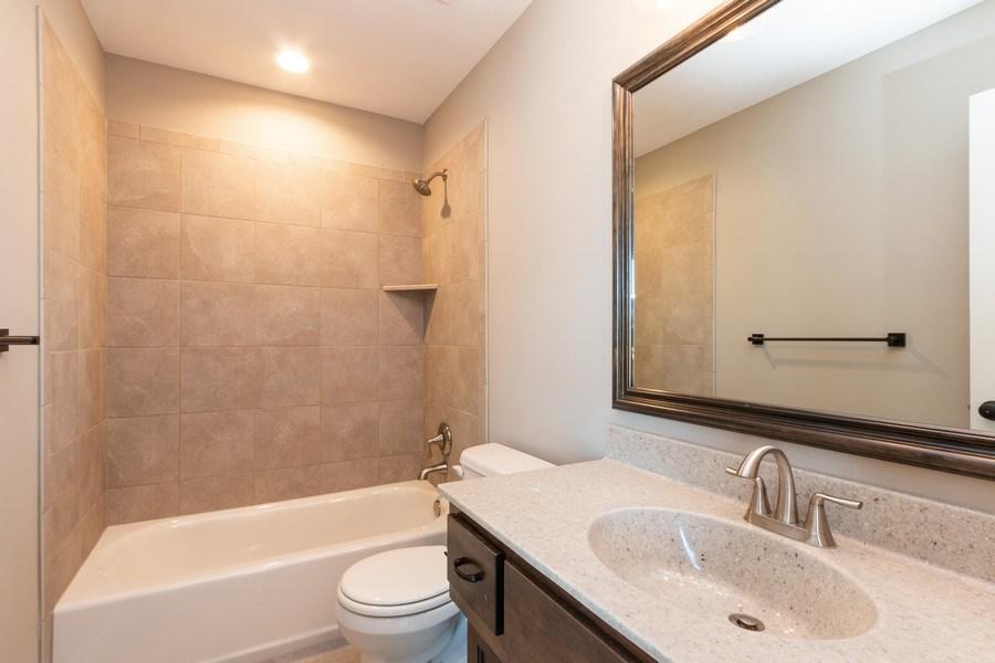 Real Estate Photography - 21601 W 93rd Ter, Lenexa, KS, 66220 - 2nd Bathroom