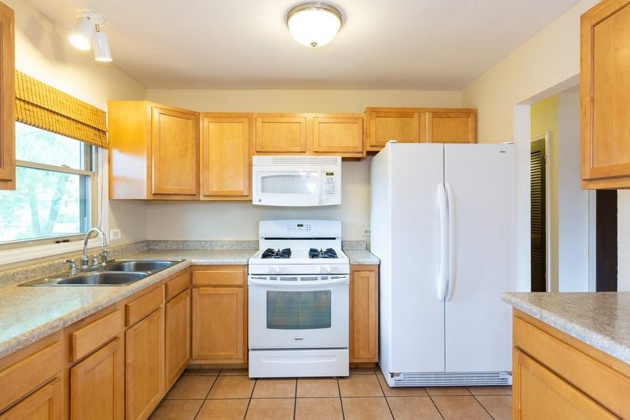 Real Estate Photography - 3009 Hopkins St, Steger, IL, 60475 - Kitchen