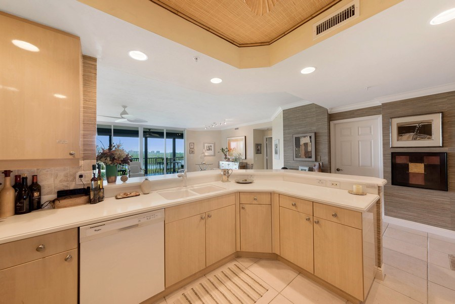 Real Estate Photography - 425 Cove Tower Dr, Naples, FL, 34110 - Kitchen