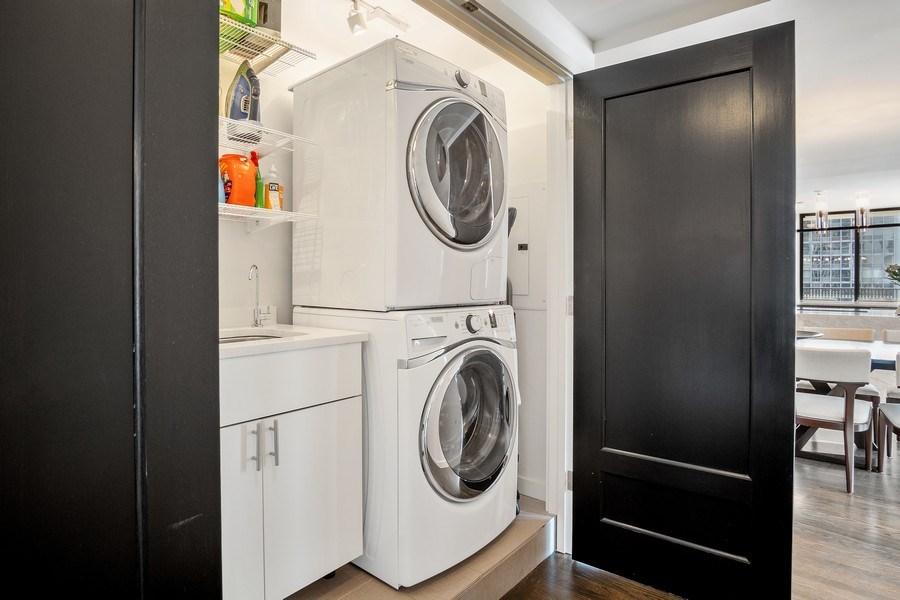 Real Estate Photography - 200 E Delaware, Unit 22D, Chicago, IL, 60611 - Laundry Room