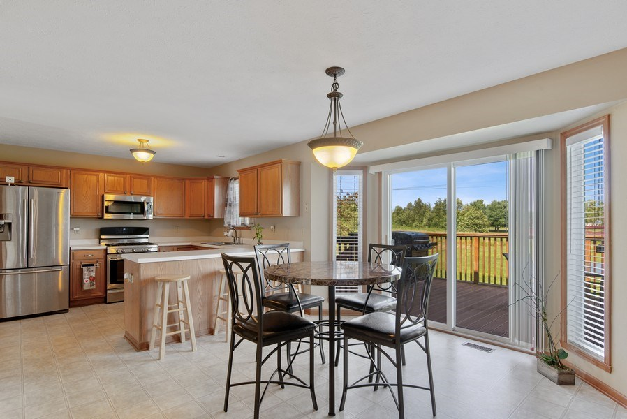 Real Estate Photography - 8960 Birdie Bend, Belvidere, IL, 61008 - Kitchen/Dining