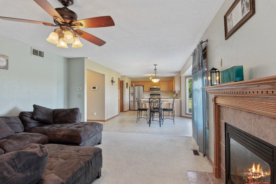Real Estate Photography - 8960 Birdie Bend, Belvidere, IL, 61008 - Family Room / Kitchen